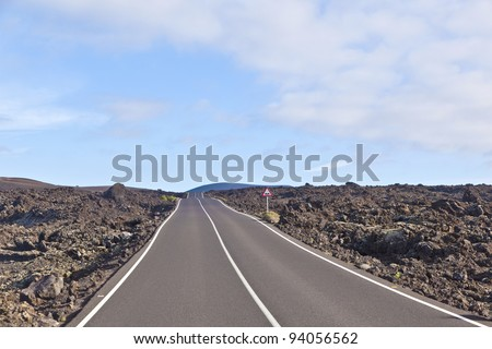 street through volcanic area in Timanfaya national park, Lanzarote, Canaries