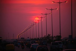 Street view, Highway traffic in sunset at new delhi, India