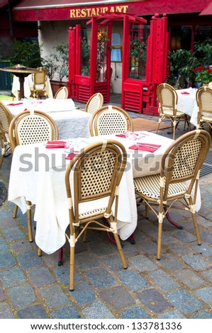 Street view of a coffee terrace with tables and chairs,paris France #133781336