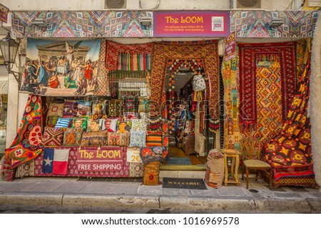 Street view of colourful fabric shop in Plaka District of Athens, Athens, Greece, Europe 12 October 2017 #1016969578
