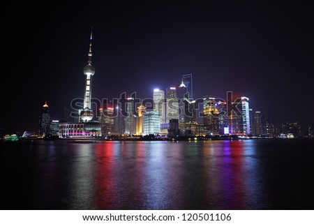 street view of downtown in shanghai at summer time