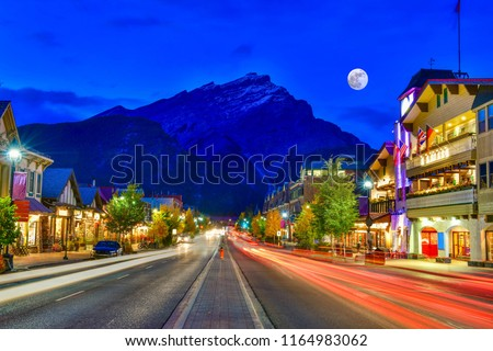 Photo of  Street view of famous Banff Avenue at twilight time. Banff is a resort town and one of Canada's most popular tourist destinations.