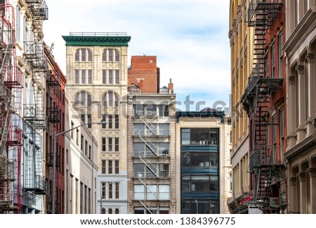 Street view of historic buildings on Broadway in the Tribeca neighborhood of Manhattan in New York City NYC #1384396775