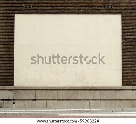 street view of large brick stone wall with empty white space