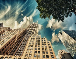 Street view of tall skyscrapers in Manhattan - New York.