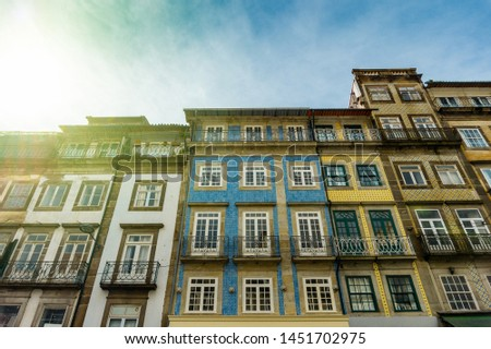 Street view on the beautiful old buildings with portuguese tiles on the facades in Porto city, Portugal #1451702975