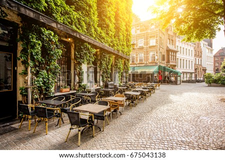 Street view with cafe terrace during the morning in Antwerpen city in Belgium #675043138