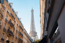 Street view with Eiffel Tower / Tour Eiffel and Parisian buildings, Paris, France