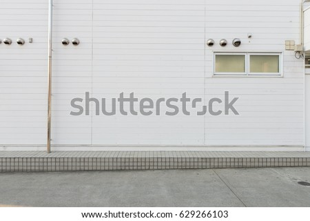 street wall background ,Industrial background, empty grunge urban street with warehouse brick wall #629266103