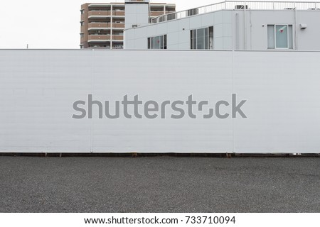 street wall background ,Industrial background, empty grunge urban street with warehouse brick wall #733710094