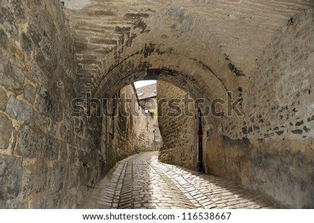 Street with a gate in the old city center of Besan���§on,France.