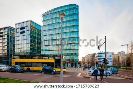 Street with bus and car traffic and modern building architecture in Potsdamer Platz Square in City centre in Berlin in Germany in Europe. Building architecture exterior.