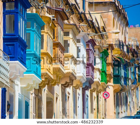 street with colorful balconies in historical part of Valletta in Malta #486232339