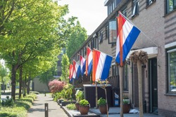 Street with dutch flags hanging outside on