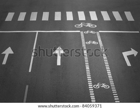 street with lanes, arrows and a cycling path