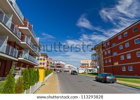 Street with new apartments at sunny day