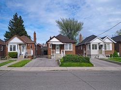 street with old fashioned 1950s style working class bungalows