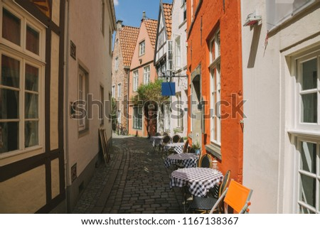 street with summer restaurant and buildings during daytime in Bonn, Germany  #1167138367