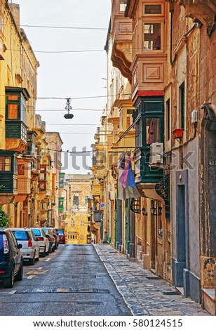 Street with traditional houses at the old city center in Valletta, Malta #580124515