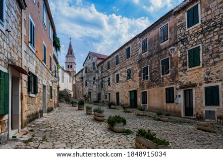 Street with typical stone houses in Postira old town, Brac island, Croatia. August 2020 Сток-фото ©