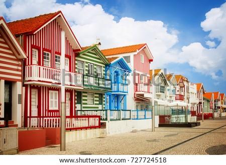street with typical striped houses Costa Nova, Aveiro, Portugal, retro toned