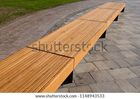 Street wooden bench in perspective, bench in the park #1148943533