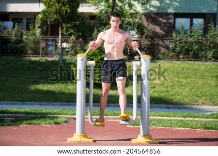 Street Workout - Handsome Muscular Man Workout In The Park