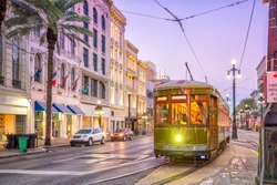 Streetcar in downtown New Orleans, USA at twilight