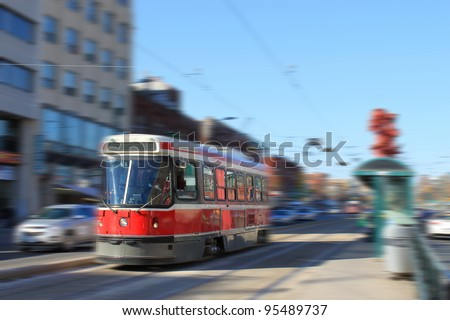 Streetcar transportation in downtown Toronto, Canada with motion blur
