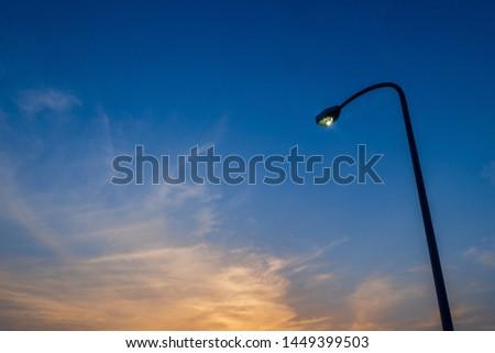 Streetlights illuminated with dusk sky #1449399503