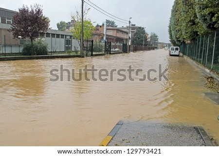 streets and roads submerged by the mud of the flood after the flooding of the River #129793421