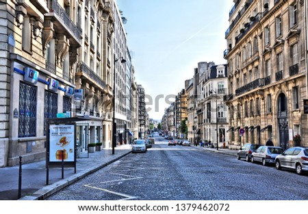 Streets in historic center of Paris, France. The city's historic center - UNESCO World Heritage Site and major tourist destination in Europe. Photo taken 2014-05-04. #1379462072