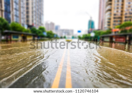 Streets inundated by heavy rain in the city. The background of urban construction and management. #1120746104