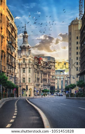 Streets of Bucharest, Romania. Victoriei Avenue at sunset.
