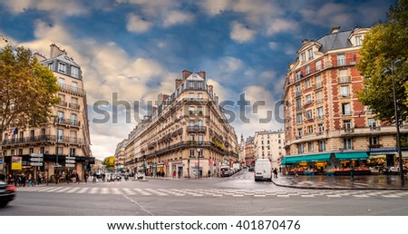 Streets of Paris, France. Blue sky, buildings and traffic. Shot in october daylight.