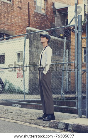 Streets Of Sadness Symbolises The Great Depression Era (1920-1930) With A Sad Man Standing Near A Chain Link Fence In A Urban Setting