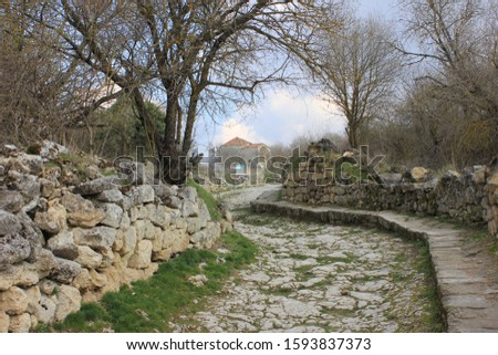 Streets of the ancient fortress city of Chufut-Kale in early spring