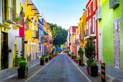 Streets of the center of the city of Puebla, various facades with bright colors and beautiful views.