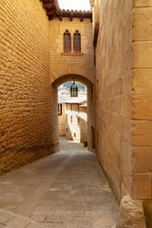 Streets with houses and old buildings from medieval times, in the town of Uncastillo, in the Cinco Villas region, in the province of Zaragoza, Aragon, Spain.