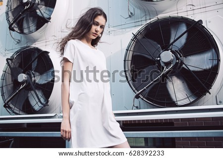 Streetstyle, fashion. Young girl in white dress standing on propellers background - Shutterstock ID 628392233