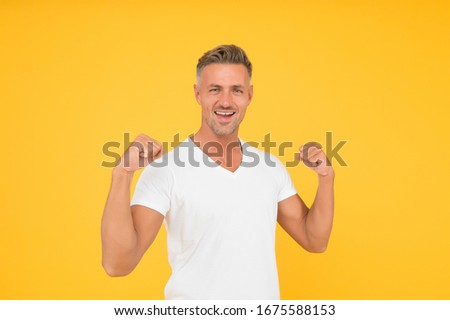 Strength and power. Happy bachelor show strength. Strong man flex arms yellow background. Strength and confident. Strength comes from within.