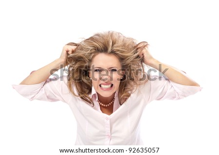 Stress / Angry beautiful woman pulling her hair in frustration. - stock photo