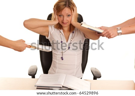 Stress at work - young business woman with too much work and under pressure and mobbing
