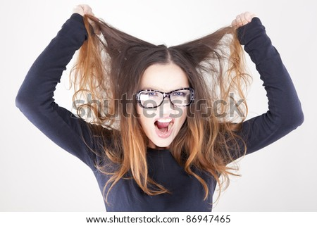 Stress. Business woman frustrated and stressed pulling her hair.