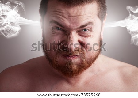 Stress concept - angry frustrated man with exploding head - stock photo