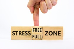 Stress free zone symbol. Doctor turns a cube and changes words 'stress full zone' to 'stress free zone'. Beautiful white background. Psychological, business and stress free zone concept. Copy space.
