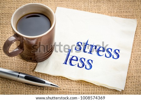 stress less advice or reminder - handwriting on a napkin with a cup of coffee