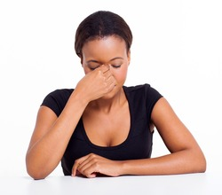 stressed african businesswoman having headache isolated on white