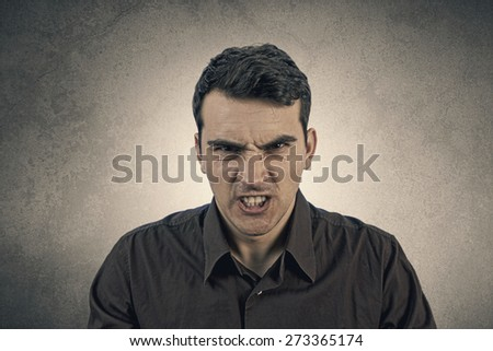Stressed, aggressive, frustrated portrait of a young student,man isolated on grey background.Facial expression #273365174