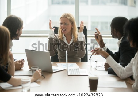 Stressed angry businesswoman arguing at meeting with diverse male colleagues, woman boss team leader confused about bad attitude and bullying, suffering from disrespect, gender discrimination at work